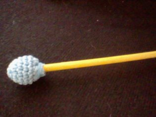 Step Two_ Crochet ball glued to painted dowel